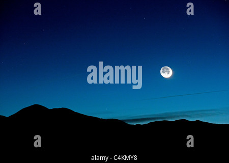 New crescent moon from Poncha Pass, Chaffee County, Colorado, USA. - Stock Photo