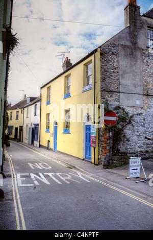 A  no entry sign along a road in Lyme regis, Dorset, England. - Stock Photo