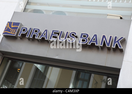 The sign on a branch of Piraeus Bank in Heraklion (Iraklio), Crete. - Stock Photo