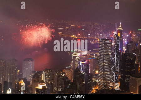 Fireworks in Victoria Harbour on National Day, Hong Kong, China - Stock Photo