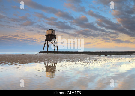 One of the unusual Victorian lighthouses at Dovercourt in England at sunrise. - Stock Photo