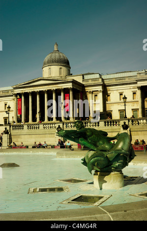 Trafalgar Square. Fountains emptied of water for cleaning with the National Gallery in the background. - Stock Photo