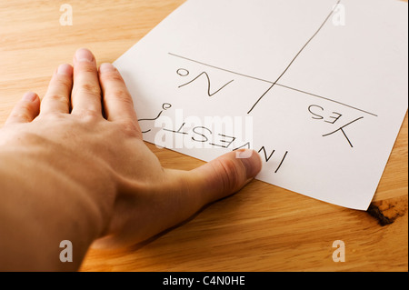 Decision of whether or not to invest being handed over in a business meeting - Stock Photo