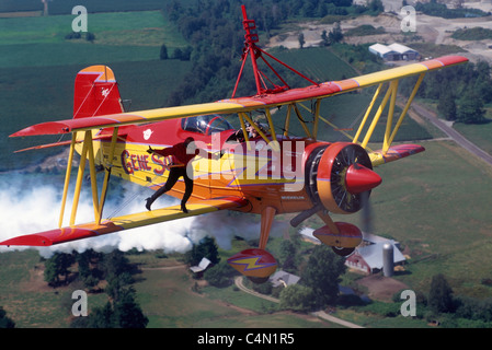 Wingwalker (Teresa Stokes) wingwalking on Gene Soucy's Biplane 'Showcat' at Abbotsford Airshow, BC, British Columbia, - Stock Photo