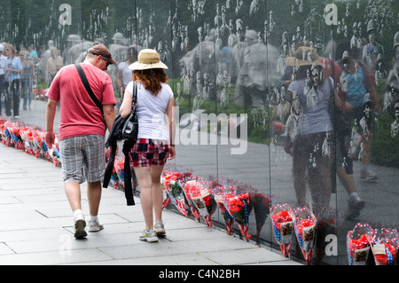 WASHINGTON DC, USA - Hundreds of bunches of flowers line the reflecting wall of the Korean War Veterans Memorial - Stock Photo