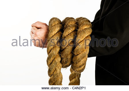 arms bound in rope - Stock Photo