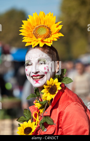 French clown with traditional white-painted face at market in La Reole, France - Stock Photo