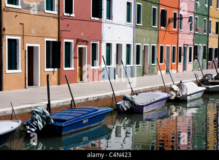 Typical Italian houses on a canal at Burano Island next to Venice, Italy - Stock Photo
