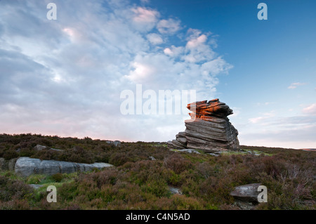 The Mother Cap rock formation on Hathersage Moor lit by late evening summer sun, The Peak District, Derbyshire, - Stock Photo