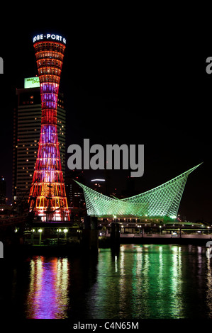 Kobe Port Tower and the Maritime Museum at night in Meriken Park, Hyogo Prefecture, Japan. - Stock Photo