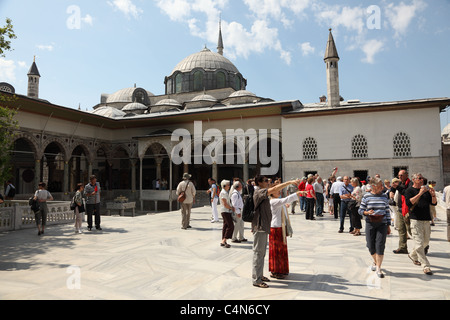 Tourists inside of the Topkapi Palace, Istanbul Turkey. Photo taken at 25th of Mai 2011 - Stock Photo