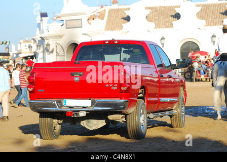 A rear view of a red pickup truck transport the pilgrimage, in the village el Rocio, Andalusia, Spain - Stock Photo