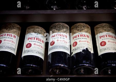 Chateau Petrus fine wine vintage 1973, 1974, 1976, 1979, 1982 on sale in St Emilion, Bordeaux, France - Stock Photo