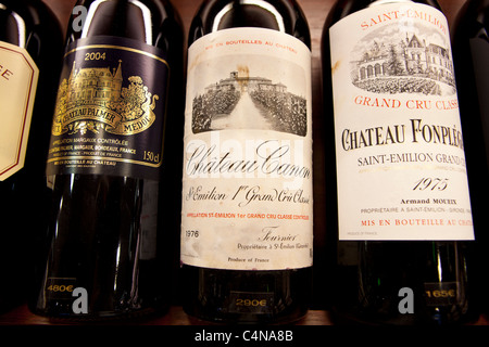 Fine wines Chateau Canon, Chateau Fonplegade, Chateau Palmer Medoc in wine merchants shop in St Emilion, Bordeaux, - Stock Photo