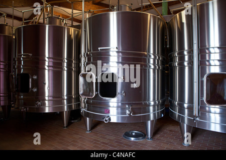 Stainless steel wine vats at Chateau Beau-Sejour Becot at St Emilion in the Bordeaux wine region of France - Stock Photo