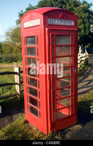 Traditional red telephone box in the countryside, Sussex, England - Stock Photo