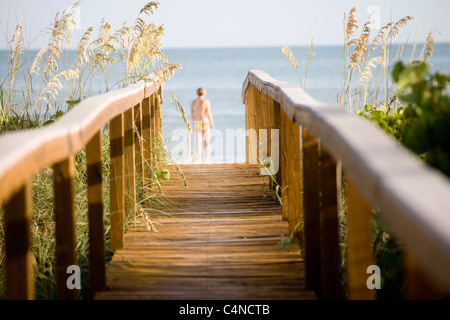 Woman at the end of boardwalk, Sanibel Island, Florida, USA - Stock Photo