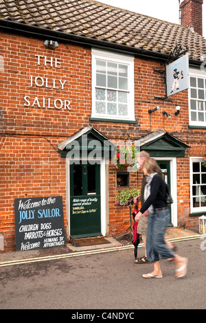 People outside the Jolly Sailor pub, Orford village Suffolk UK - Stock Photo