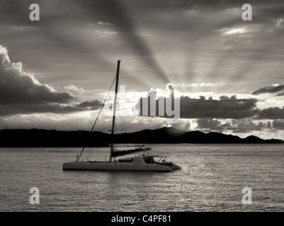 Sailboat off St. John, Virgin Islands and sunset. - Stock Photo