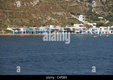Brightly painted fishermen's houses in Klima fishing village on the Cycladic Island of Milos in Greece - Stock Photo