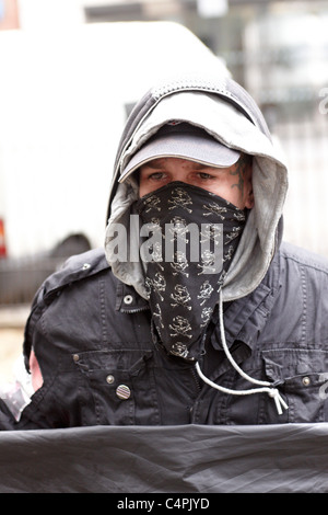 Royal Wedding 2011: Masked anarchist poses for photographers well away from the procession route - Stock Photo