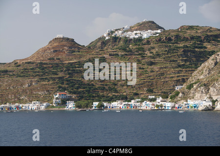 Fishing village Klima with Plaka and Kastro above on the Cycladic Island of Milos in Greece - Stock Photo