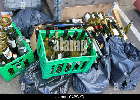 Empty wine bottles that are going for recycling - Stock Photo