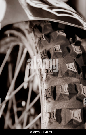 Artistic close-up of a racing bike tire tread Sepia toned - Stock Photo