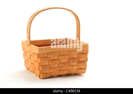 Small wicker basket isolated on white background - Stock Photo