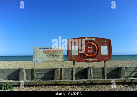 Lifebuoy and water safety sign by the beach at Ferring near Worthing West Sussex UK - Stock Photo