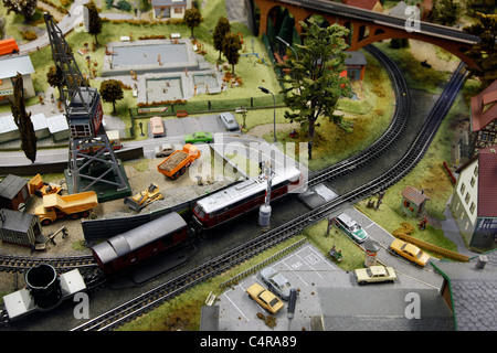 Miniature model railway plant with courses and buildings - Stock Photo