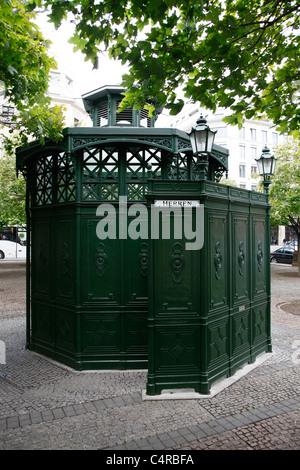 Public toilet in Berlin Germany - Stock Photo