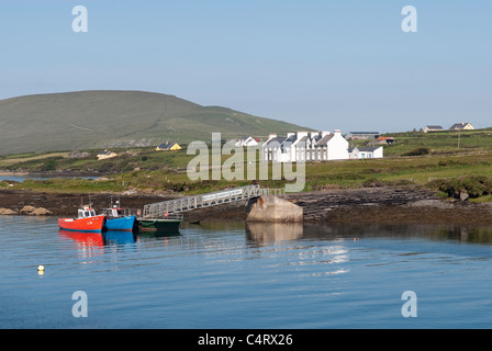 Cottages and jetty on Valentia Island opposite the small harbour of Portmagee Co Kerry, Republic of Ireland - Stock Photo