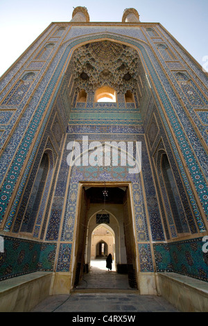 Woman entering the Friday mosque (Masjed-e Jame) in Yazd, Iran - Stock Photo