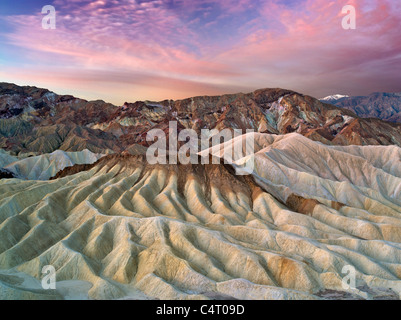 Eroded cliffs and sunrise from Zabriskie Point. Death Valley National Park, California - Stock Photo