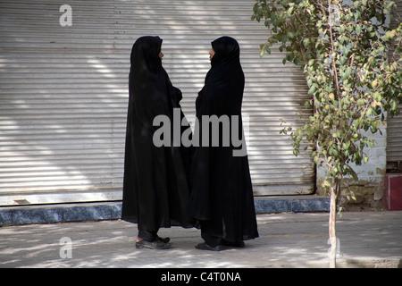 Female friends chatting in Yazd, Iran - Stock Photo
