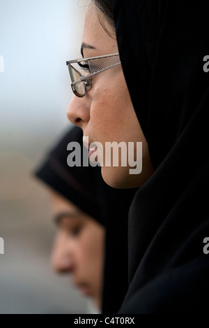 Two female friends enjoying the view from the top of Zoroastrian complex of Amir Chakmak in Yazd, Iran - Stock Photo