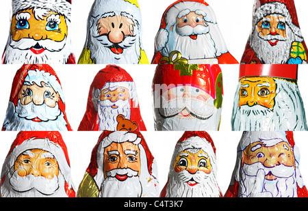 Chocolate Santa Claus figures, faces, portrait. Christmas time sweets. - Stock Photo
