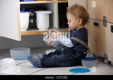 Little boy, 1 year old, is exploring his home. curiously exploring the apartment. - Stock Photo