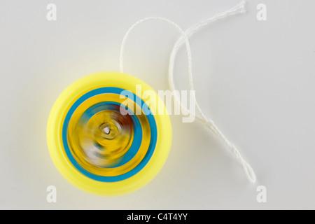 Yellow kiddies yoyo - Stock Photo