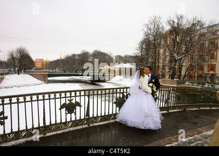 Wedding Couple being photographed kissing on bridge over Moika River, 'St Petersburg' Russia - Stock Photo