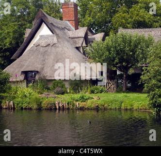 Thatched Bridge Cottage at Flatford, East Bergholt, Suffolk, England - Stock Photo