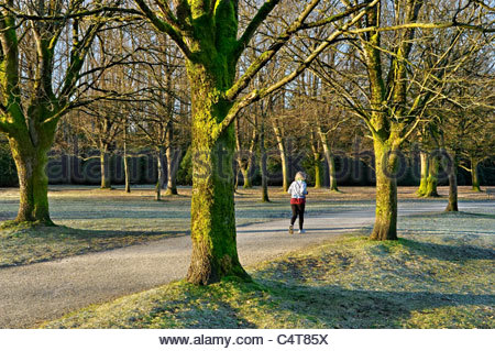 Female jogger, Jericho Beach Park, Vancouver, British Columbia, Canada - Stock Photo