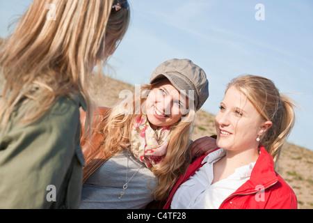 Teenagers Talking Outdoors - Stock Photo