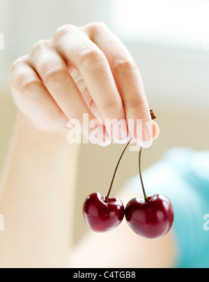 Girl holding Cherries - Stock Photo