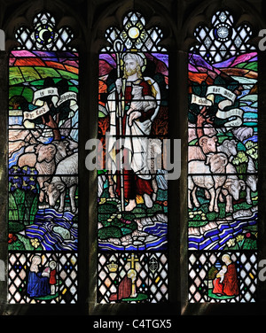 Colourful stained glass window depicting Christ the Shepherd, Muker Church, Swaledale, Yorkshire, England - Stock Photo
