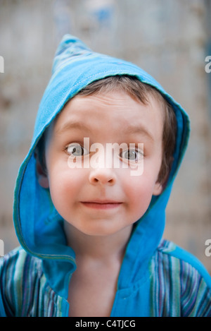 Little boy looking at camera with surprised expression, portrait - Stock Photo