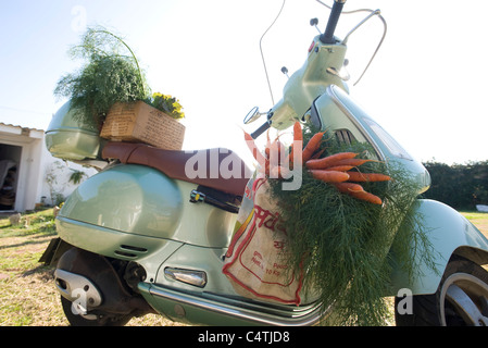 Fresh produce on motor scooter - Stock Photo