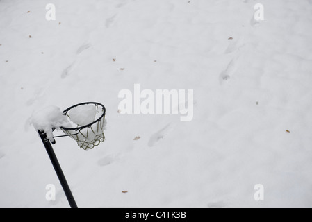 Basketball hoop covered in snow - Stock Photo