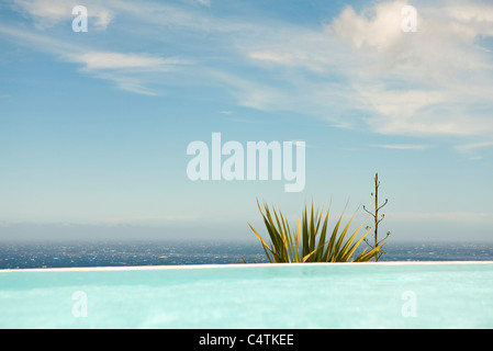 Swimming pool, sea in background - Stock Photo